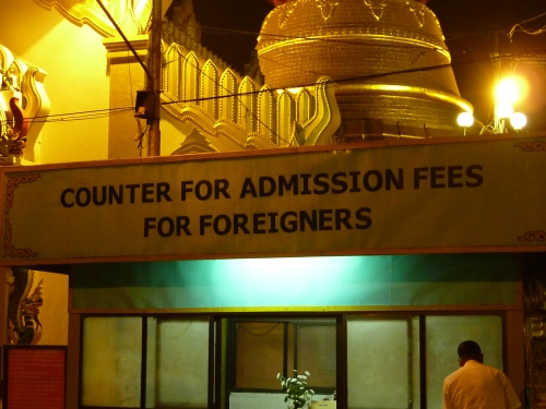 A sign at the entrance to a pagoda complex in Yangon. Entrance fees would be fine if they were paid to the monastery and not directly into the government's pocket.